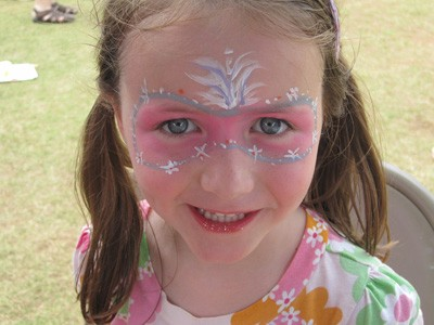 Little girl with pink face paint