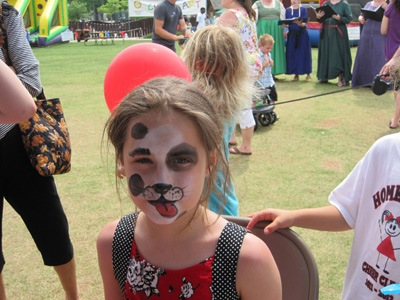 Little girl with puppy dog face paint