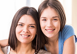 Two young women smiling together