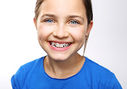 Little girl with orthodontic appliance