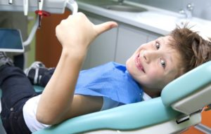 A smiling child at his dental appointment.